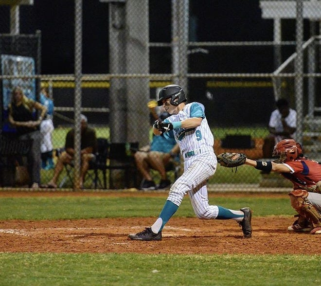 Jensen Beach catcher Caleb Pendleton takes a swing in a game early this season. Pendleton, who has signed with Florida Atlantic, could be selected in the Major League Baseball draft.