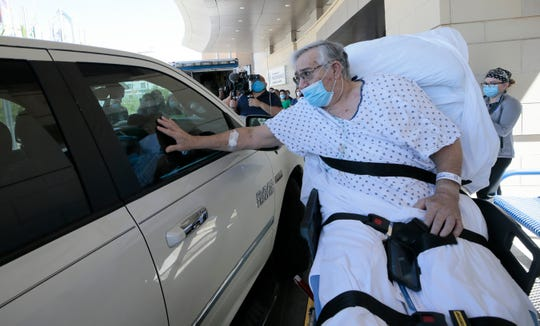 Roberto Mata, 68, pressed his hand against a truck window in a reunion with his wife, Mary Alice Mata, after his release from The Hospitals of Providence Memorial Campus on May 27.  He beat COVID-19 after a 47-day hospital battle. Mary Alice Mata, who also has COVID-19, had to greet him through the glass to protect him against reinfection.
