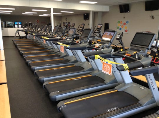 Every other treadmill at the Aspirus Branch of the Woodson YMCA has been blocked off to ensure social distancing of users.