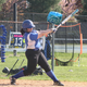 Port Chester's Samantha Fiorino takes a swing during a softball game.