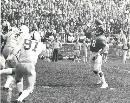 Chuck Ealey fires a pass for the University of Toledo during his 35-game winning streak that helped ignite Christine Brennan's love of sports.