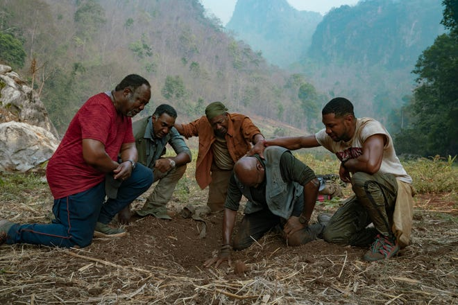 """Isiah Whitlock Jr. (from left), Norm Lewis, Clarke Peters, Delroy Lindo and Jonathan Majors star in Spike Lee's war film """"Da 5 Bloods,"""" centering on African-American veterans who return to Vietnam."""