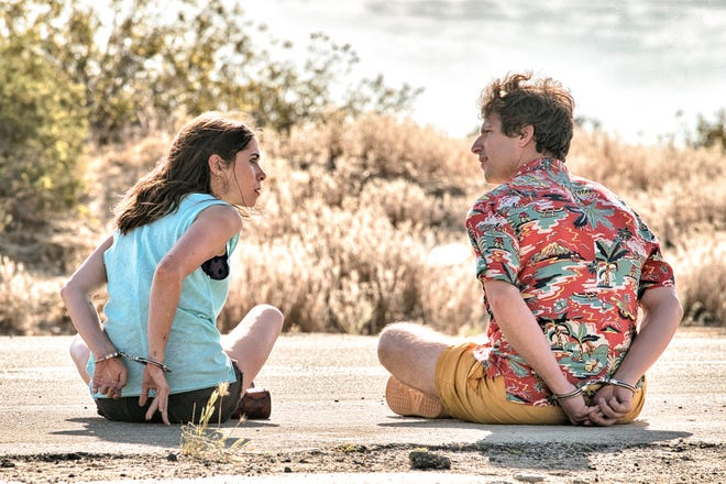 "Carefree Nyles (Andy Samberg, right) and reluctant maid of honor Sarah (Cristin Milioti) have a chance encounter at a wedding and then get stuck in a time loop in the romantic comedy ""Palm Springs."""