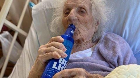Jennie Stejna is treated to a cold Bud Light to celebrate her recovery from coronavirus.