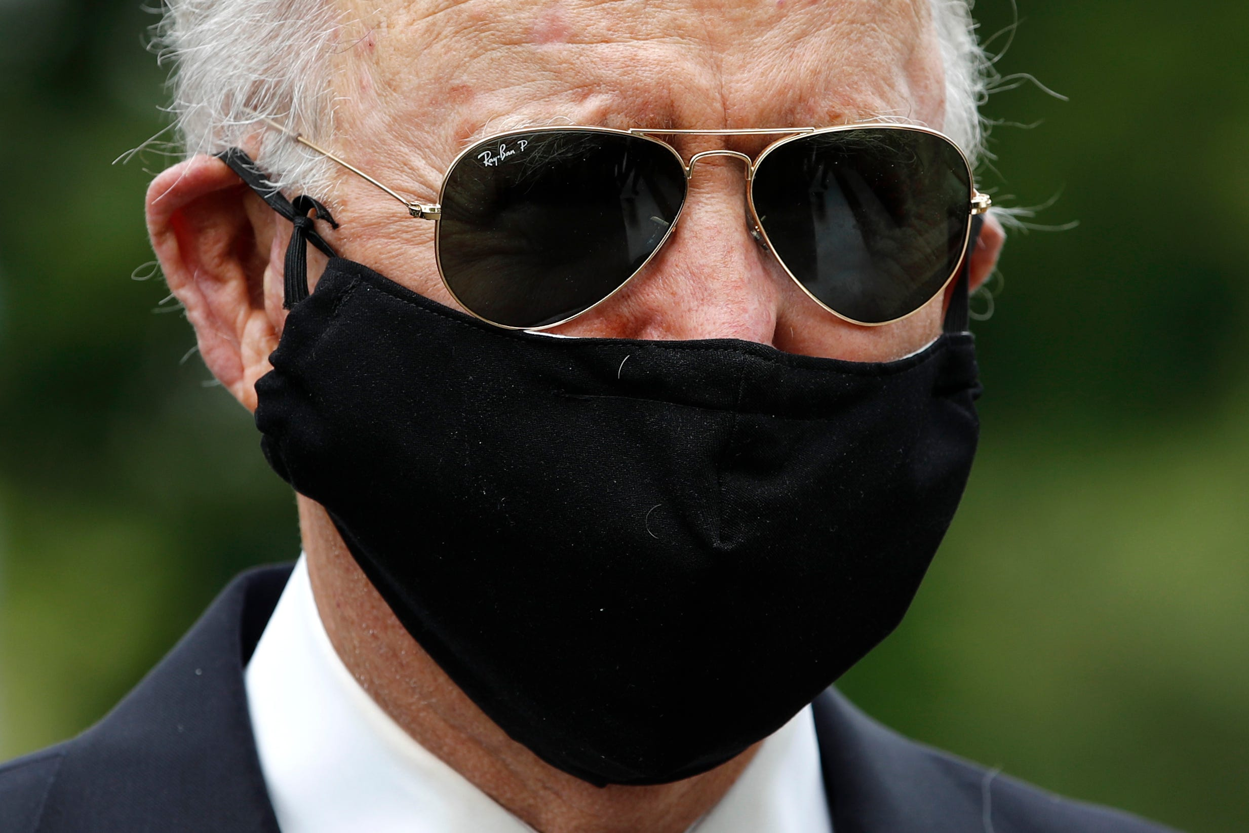Falsely masculine : Biden hits Trump over face masks as president calls them  politically correct