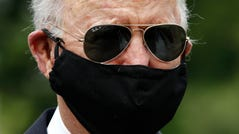Democratic presidential candidate, former Vice President Joe Biden wears a face mask to protect against the spread of the new coronavirus as he and Jill Biden depart after placing a wreath at the Delaware Memorial Bridge Veterans Memorial Park, Monday, May 25, 2020, in New Castle, Del. (AP Photo/Patrick Semansky) ORG XMIT: DEPS104