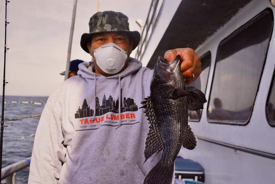 Dan Signal of Trenton with a sea bass landed on the 125-foot Jamaica party boat.