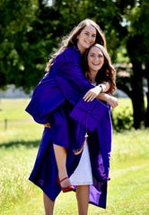 Megan Bynum, the salutatorian for the Early High School Class of 2020, jumps on the back of her twin sister, Rae Bynum, who was named valedictorian of the senior class. They're believed to be the first set of twins to accomplish the feat in school history.