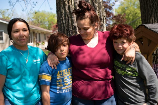 Amber Laclair poses for a portrait with her children Mariah Laclair, 14, Emilio Ortiz-Laclair, 9, and Adrian Ortiz, 10, on Thursday, May 21, 2020 at her friend's house in Breckenridge, Mich. Amber's fiance Jose Gomez-Santiz was detained by ICE in January, their plan to get married by the court magistrate was put on hold because of coronavirus.