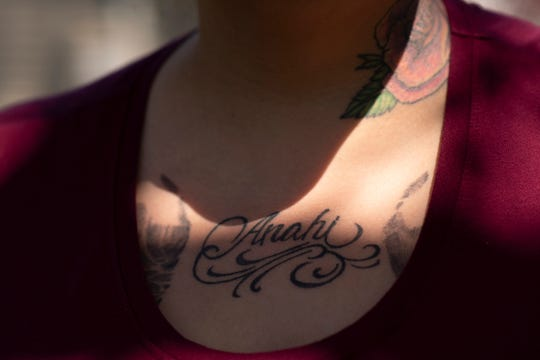 Amber Laclair's tattoo of her late daughter Anahi Ortiz is illuminated by sunlight on Thursday, May 21, 2020 on her friend's lawn in Breckenridge, Mich. Laclair's fiancée, Jose Gomez-Santiz, is detained at Calhoun County Correctional Center.