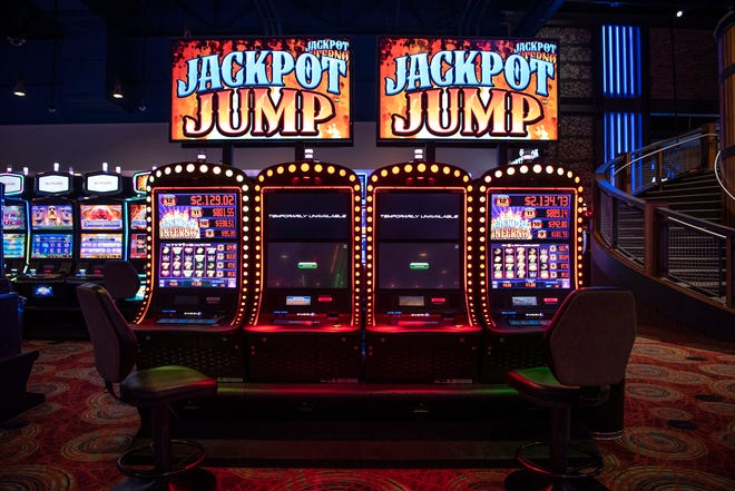 Every other slot machine at Firekeepers Casino is turned off to promote social distancing on Thursday, May 28, 2020 in Battle Creek, Mich. The casino will reopen to the public on Monday with a full series of safety measures, such as taking guest's temperatures upon arrival.