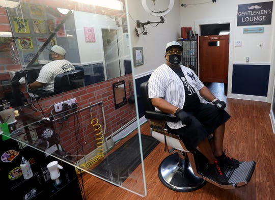 Reuben Wilkins in his chair at the Barber Lounge on Pacific Avenue in Bremerton on Thursday.