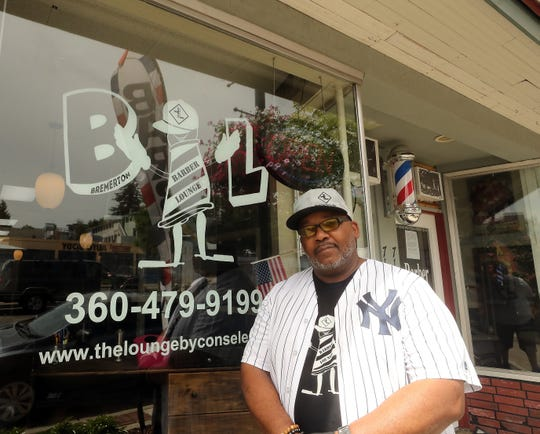 Reuben Wilkins at his Barber Lounge on Pacific Avenue in Bremerton on Thursday.
