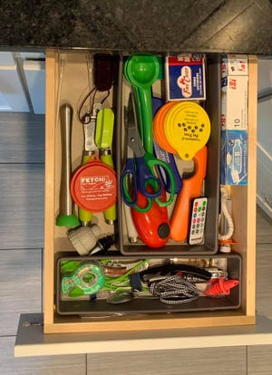 Here's my junk drawer. I promise it's not as neat as it seems.
