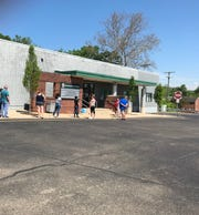 A line backs out the door on Wednesday, the day after BMV's across Ohio reopened.