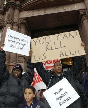 Students demonstrate outside City Hall Wednesday, Dec.10, 2003, in Cincinnati, after some of them spoke at a city council meeting on their concerns over the death of Nathaniel Jones in police custody.