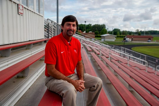 Todd Hood, head coach for the Rossview Hawks football team, poses for a portrait in the football stadium at Rossview High School in Clarksville, Tenn., on Wednesday, May 27, 2020.