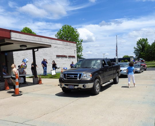 A drive-thru card shower was held for the retiring Sharon Burns and Martha Richardson Wednesday at Hopewell School. People honked horns, waved, dropped off cards and gave other gifts like flowers and balloons.
