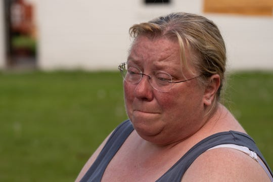 Angela Griebe of Essexville gets emotional while talking about the home her sister Andrea Skrocki of Bay City owns as they clean items from her basement that were involved in flooding that went through the area on Wednesday, May 27, 2020 in Tawas City.