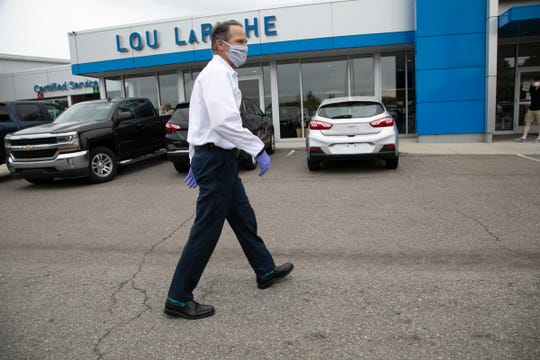 Scott LaRiche, Vice President of Lou LaRiche Chevrolet in Plymouth, is staying very busy on Thursday as car dealerships in Michigan can now open their showrooms to customers by appointment only.