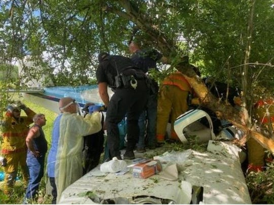 Emergency responders from the Cambridge Fire Department, United Ambulance and the Guernsey County Sheriff's Office joined forces with civilians to free a Michigan man from the heavily-damaged Beech 35-A33 he was piloting after it crashed near a field near Cambridge on Wednesday, May, 27, 2020.