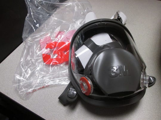 Counterfeit 3M face masks seized by federal agents with HSI, part of ICE and DHS.