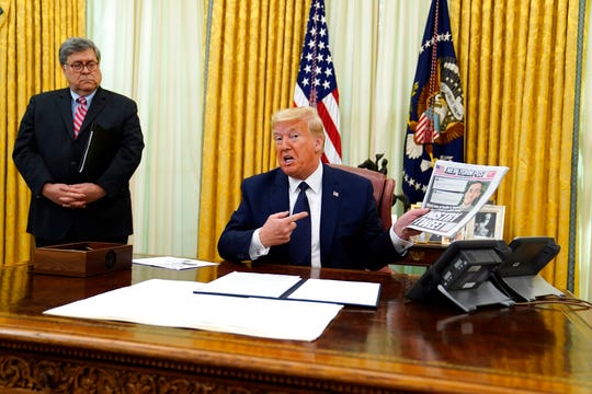 President Donald Trump speaks before signing an executive order aimed at curbing protections for social media giants, in the Oval Office of the White House, Thursday, May 28, 2020, in Washington, as Attorney General William Barr listens.