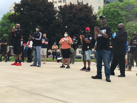 Demonstrators participate in a protest against brutality at the Michigan Capitol on Thursday, May 28, 2020.