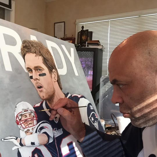 Chuck Christian paints a portrait of Tom Brady.
