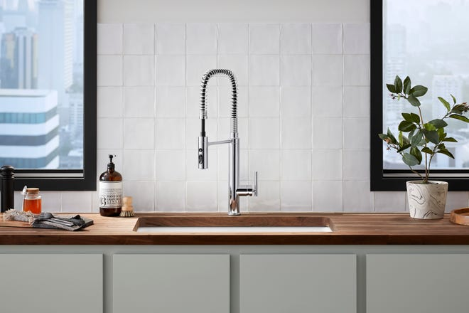 There are three types of kitchen faucets with built in spray heads: pull-out, pull-down and spring-loaded.