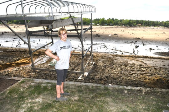 Nancy Gorton of Sanford is still stunned over the empty Sanford Lake at her home along Lake View Road in Midland.