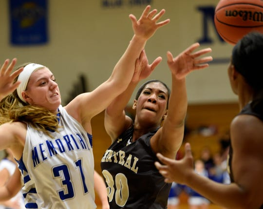 Reitz Memorial's Stephanie Sherwood (left) and Central's Zuri Sanders battle for a rebound during Friday's semifinals of the Banterra Bank SIAC Tournament at Reitz Memorial High, Jan. 16, 2015.