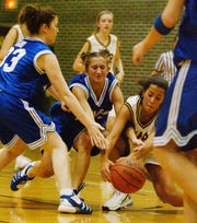 New Harmony's Erica Alsop (33), left, and Jackie Moore (25), center, battle with Central's Jenna Richie (22) for a loose ball during a 2004 game at Central High School.
