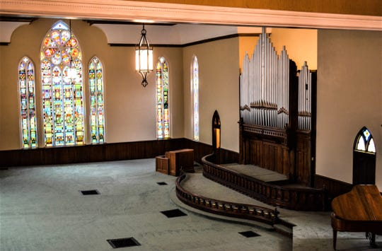 This view from the rotunda balcony highlights the original stained glass windows and  massive pipe organ in the sanctuary where President and Lucy Hayes once attended church services. Had the Mortons kept the church, they would have converted this room into a living room.