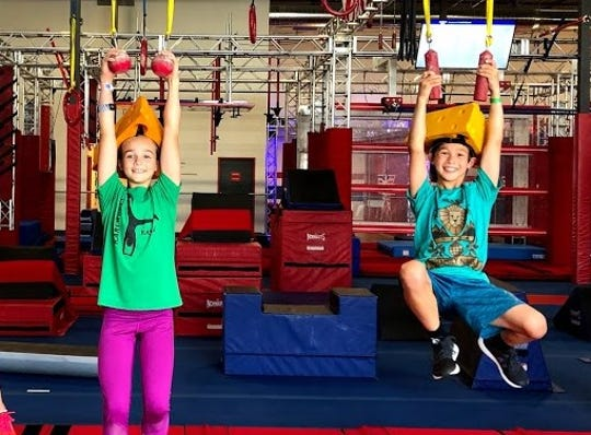 """Kayla Dodge of Broomfield, Colorado, and Owen Pham of Arlington Heights, Illinois, became friends after competing together on """"American Ninja Warrior Junior"""" and discovering they were both Packers fans. The Pham family was able to see its first game at Lambeau Field, thanks to tickets from the Dodge family."""