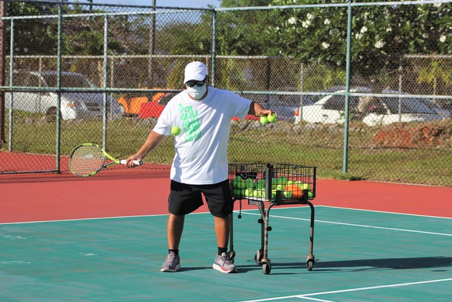 Tennis Academy of Guam coach Joe Cepeda practices in this photo submitted by TAG.