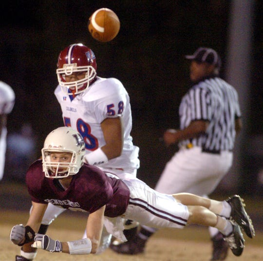 Henderson County's John Nord (13) glides to the ground as he misses the throw by Will Fidler during the 2005 playoff game against Christian County.