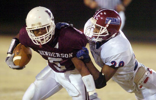 Henderson County's Antoine Lightfoot (5) tries to shake off  a Christian County player during the 2005 playoff game.