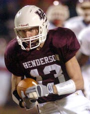 Henderson County's John Nord runs into the end zone during their 2005 football game against Christian County.