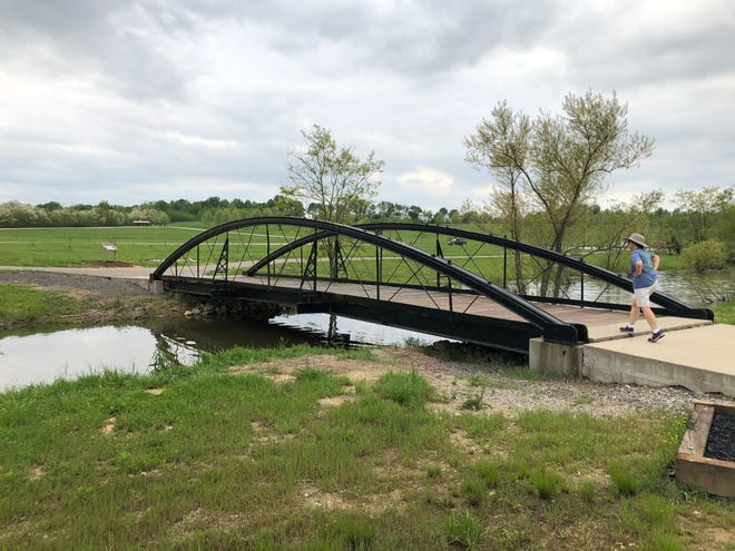 A refurbished 1880-era bowstrong pony bridge that once carried traffic across a creek near Augusta, Ky., is now a footbridge in Sandy Lee Watkins Park on Kentucky 351 just west of Hebbardsville. Henderson County Engineer Bill Hubiak, who procured the bridge after it was judged unsafe for vehicle traffic and oversaw its refurbishment and placement here in 2017, hopes to locate three more bridges of different engineering styles for use along walking trails in ithe county park.