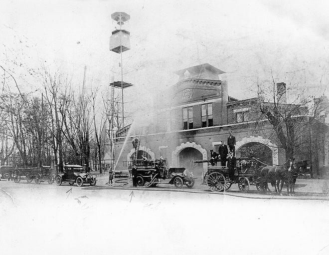 Original  Fire Station No. 1 built 1895-96 on what is now the parking lot for the Henderson County Courthouse. It was used nearly 75 years and demolished in May 1970. This photo was taken sometime  mid-1923 to mid-1925  toward the end of the transition from horse-drawn wagons to fire trucks.
