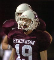Henderson County's Keith Carroll (19) reacts to the play after Chanse Greer picked up the fumble and ran into the end zone for Henderson County's first touchdown during the 2005 playoff game against Christian County.