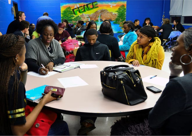 tnAchieves used its mentor program of volunteers, who are a part of several different career paths and at a different stages, to help create the webinars for virtual community service. Pictured is a stock image of a tnAchieves mentor and students.