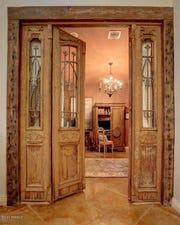 "Intricately carved antique wood doors lead to a beautiful office, or bedroom, with a full bath. This mansion in the heart of ""Old Lafayette,"" located at 109 Mossy Oaks, has 5 bedrooms, 4.5 bathrooms in 5,100 square feet, and on the market for $1,450,000."