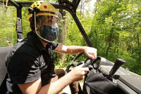 At Hocking Hills Canopy Tours, course manager Eric Lapchenko guides his ATV around to check on guests zip lining.