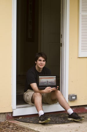 Alan Thompson, shown at his Green Oak Township home on May 27, 2020, was limited to working on a school-provided laptop during the final months of his sophomore year at Brighton High School in the spring.