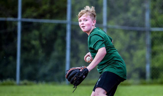 Ashton Renfro practiced fielding with his parents at the Prairie Village ballfield on Thursday, May 28, 2020. With no games on the schedule, the Renfros took advantage of some field time to work on fundamentals.