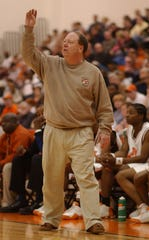 Mansfield Senior coach Gregg Collins yells out instructions to his players in 2005 against Massillon at Pete Henry Gym. Mansfield Senior's victory over Massillon gave Collins his 300th career win.