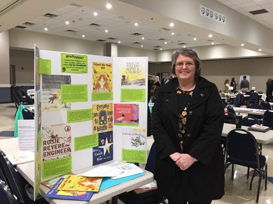At the Elementary PCN learning fair, Tammy Smitherman shows how she acted on what she learned about social emotional learning.