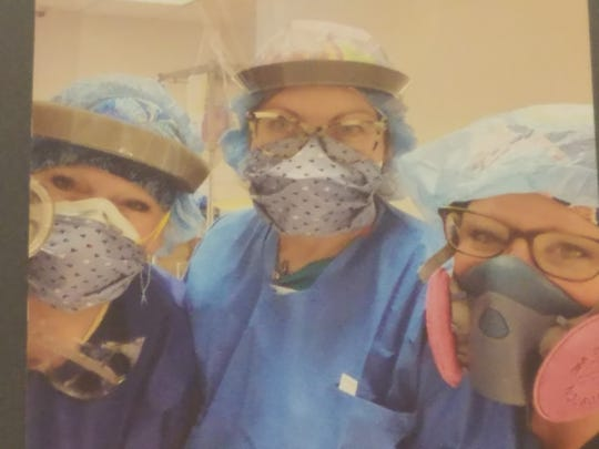 Certified Registered Nurse Anesthesiologist Beth Tuma of Granville (left) is shown with a couple of her co-workers at Kings County Hospital in Brooklyn, New York.